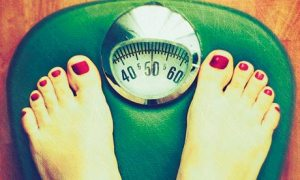 Person-weighing-themselve-007