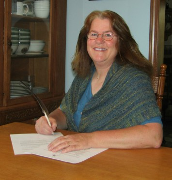 pegg-signing-contract-4-10-22-17.jpg